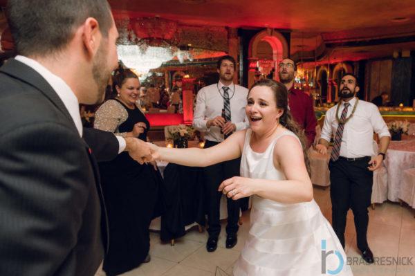 Bride rushing towards Wedding DJ on dancefloor