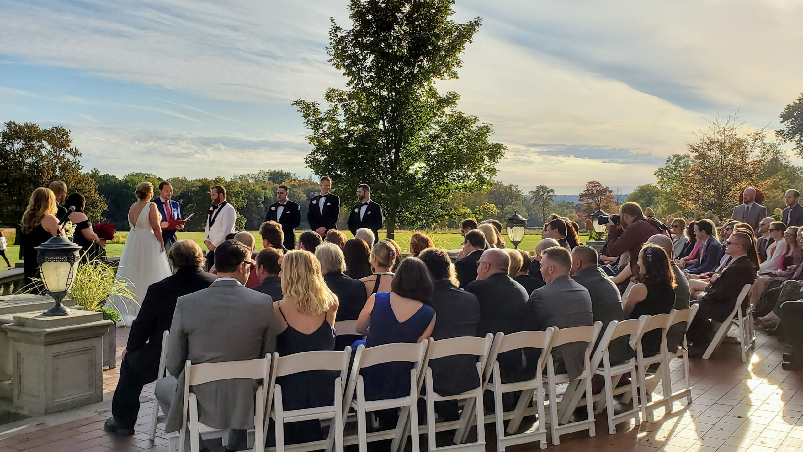 Seated guests at outdoor ceremony at park for Waveny House Wedding