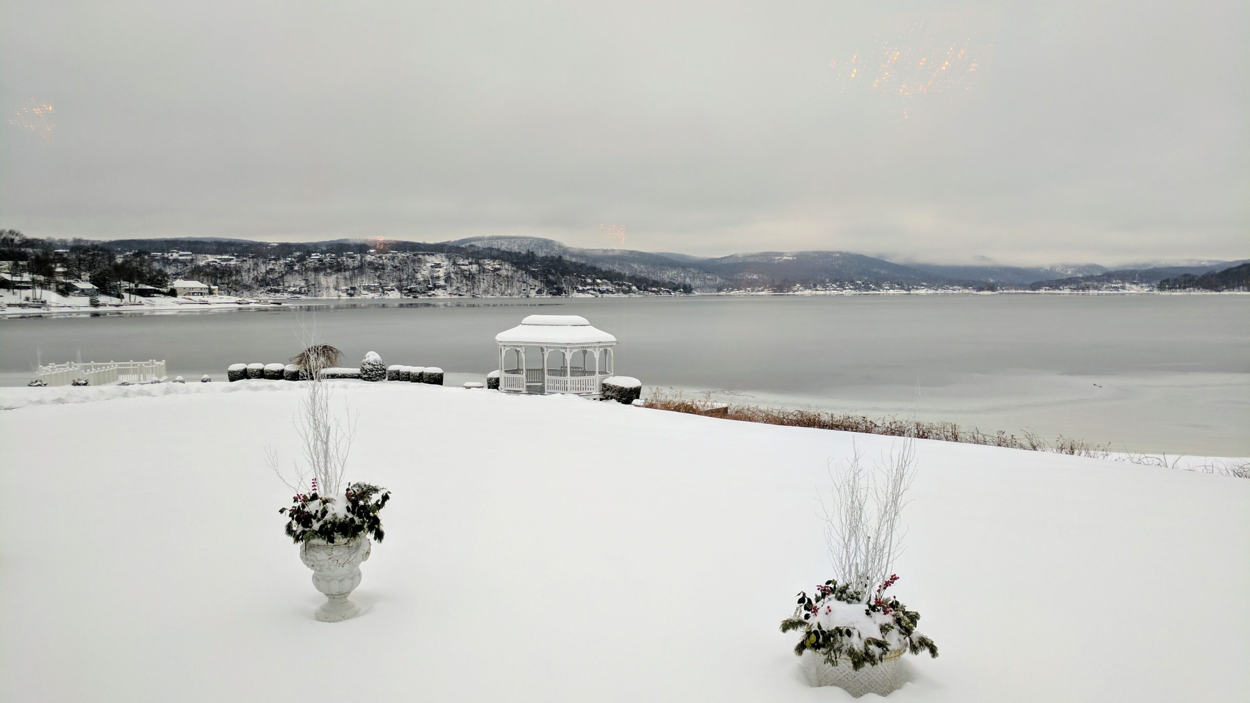Scenic winter landscape overlooking snow covered lake with gazebo in background at Candlewood Inn Wedding