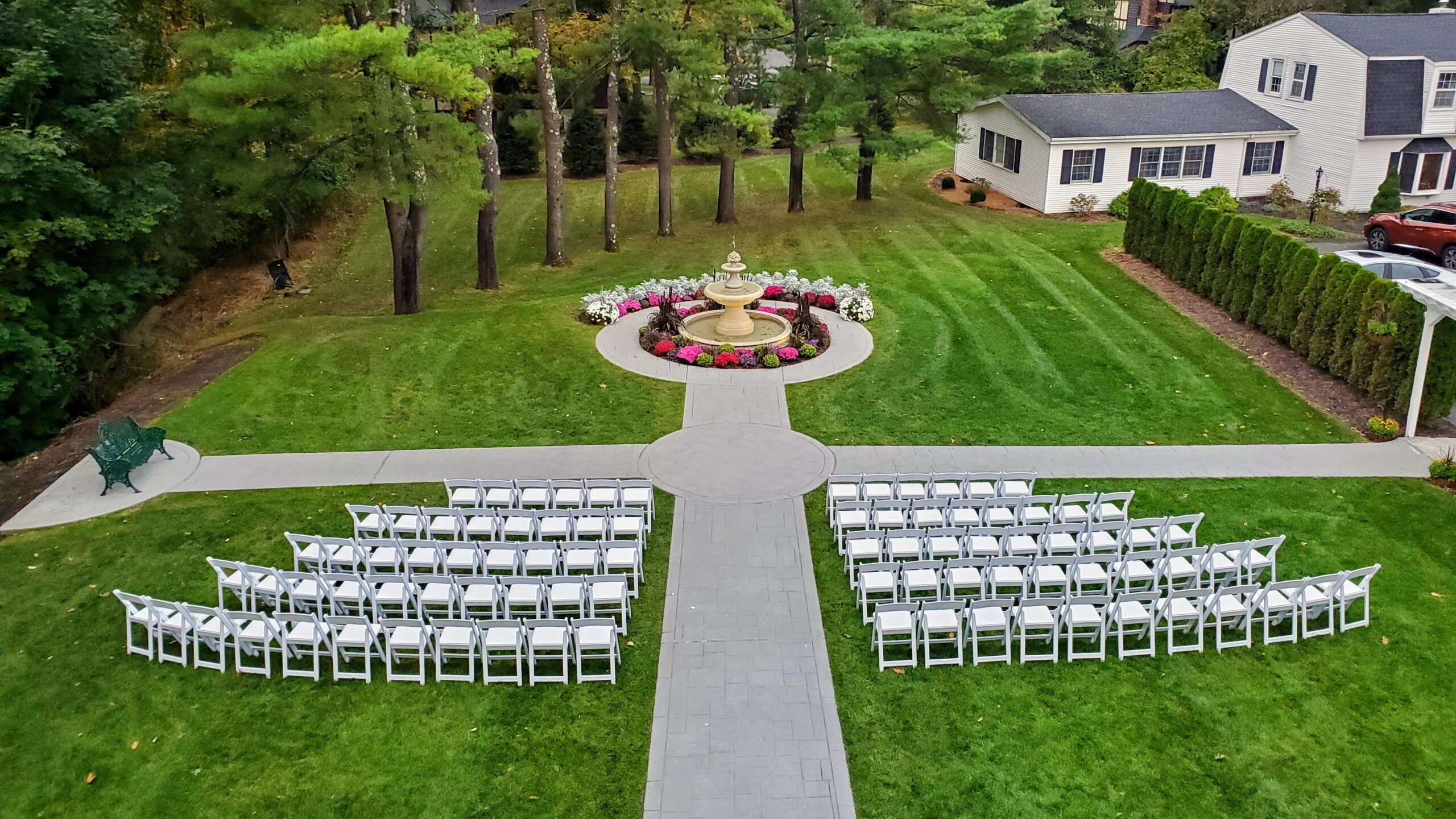 Wedding Ceremony Chairs in grassy field with trees in background during Fox Hill Inn Wedding