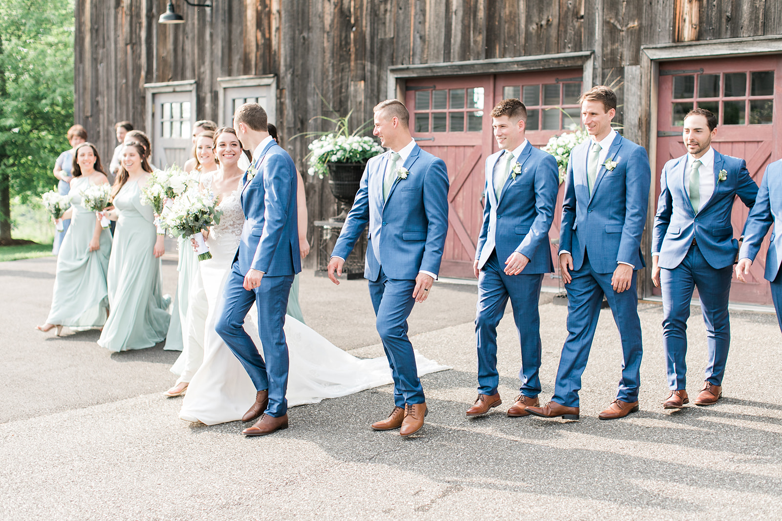 Wedding Party photo with rustic barn in background at Lion Rock Farm wedding