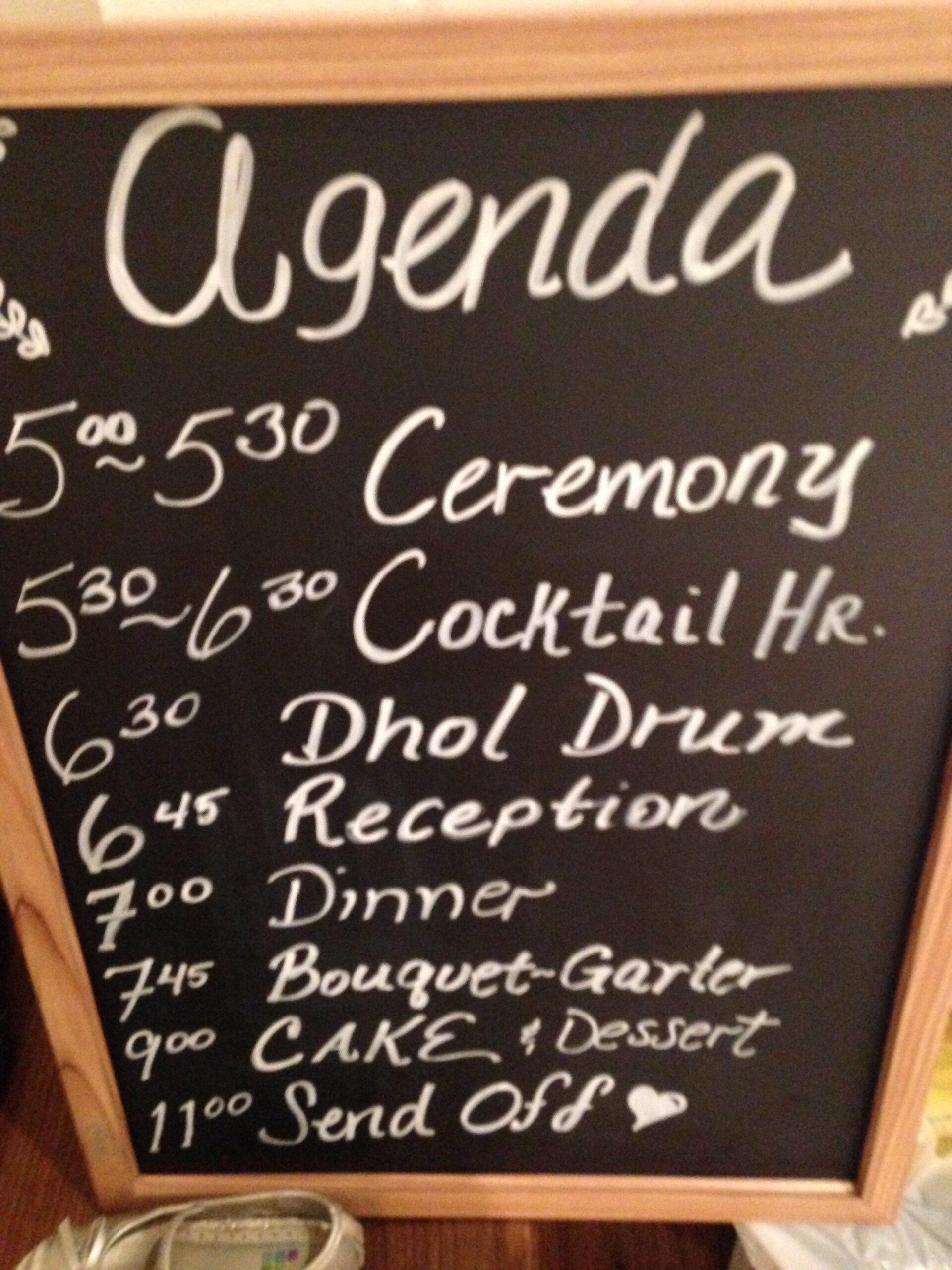 Agenda on blackboard with white chalk for a Bollywood Greenwich Hyatt Wedding