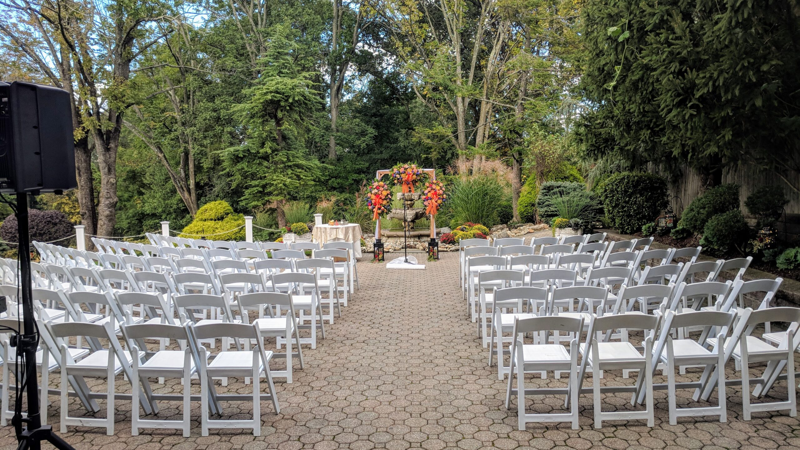 Ceremony seating with white chairs outside for a Fall Wedding at Mayfair Farms NJ