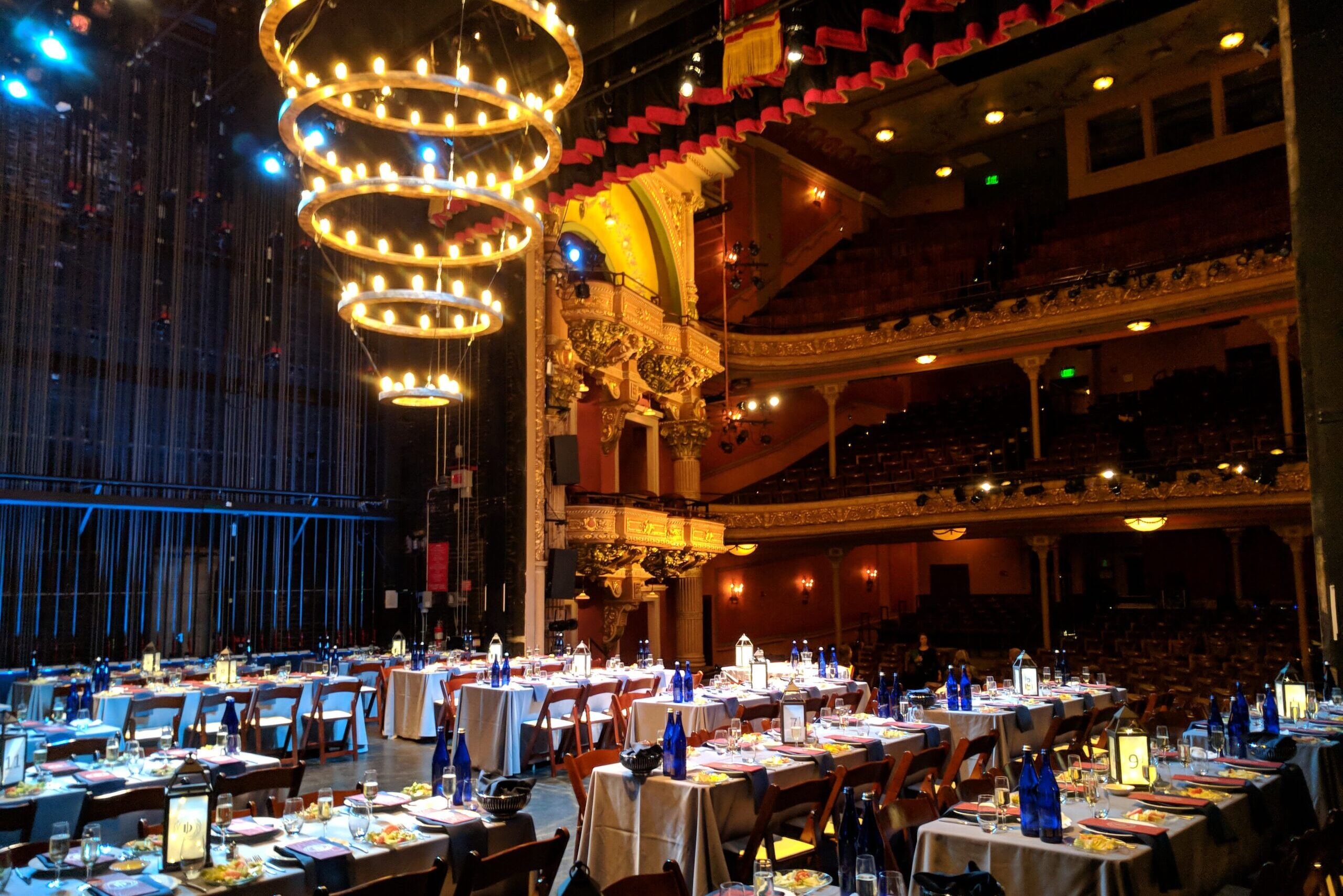 Dinner tables decorated for wedding at The Colonial Theatre on stage