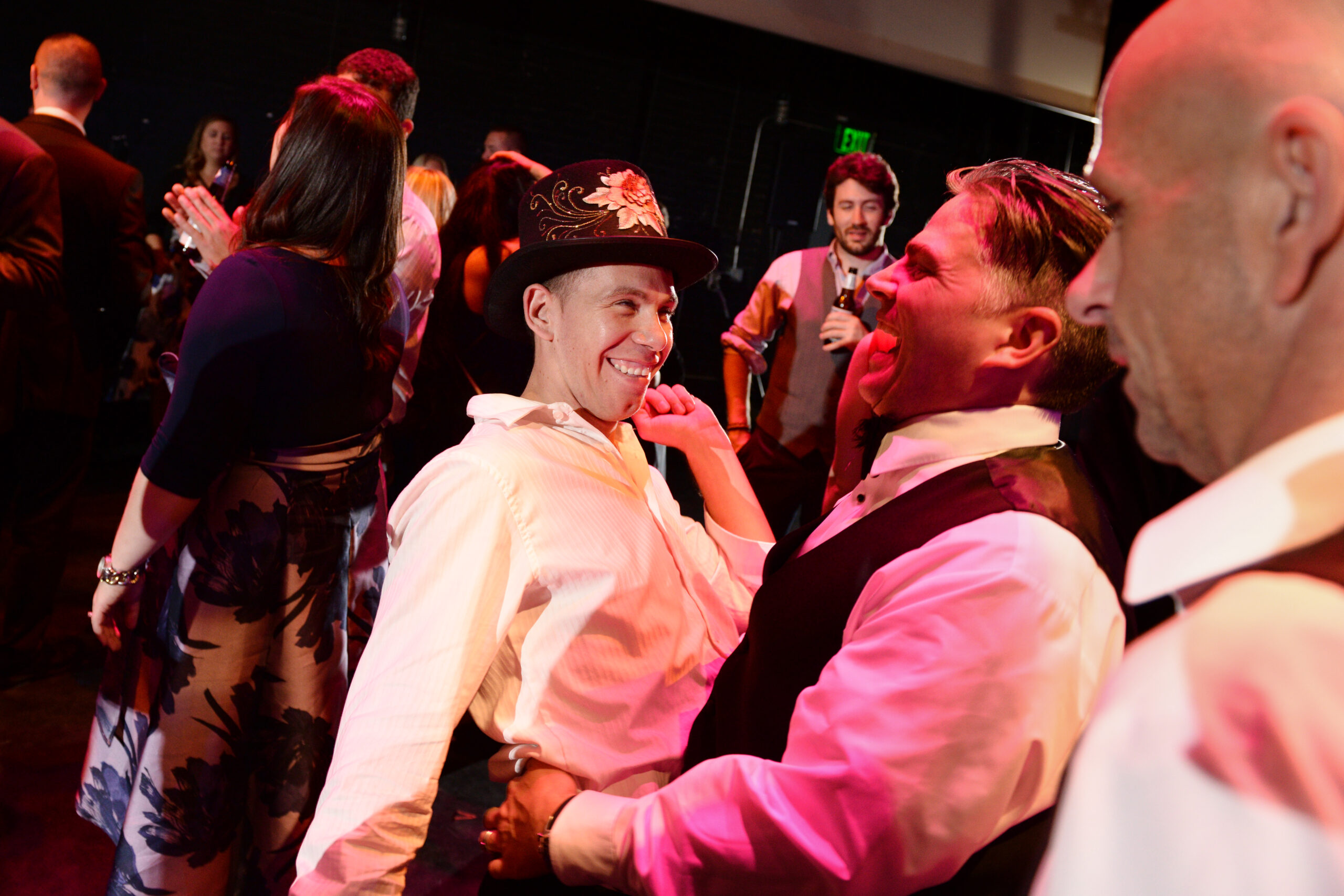 Happy guests with flamboyant hat on dancefloor at The Colonial Theatre