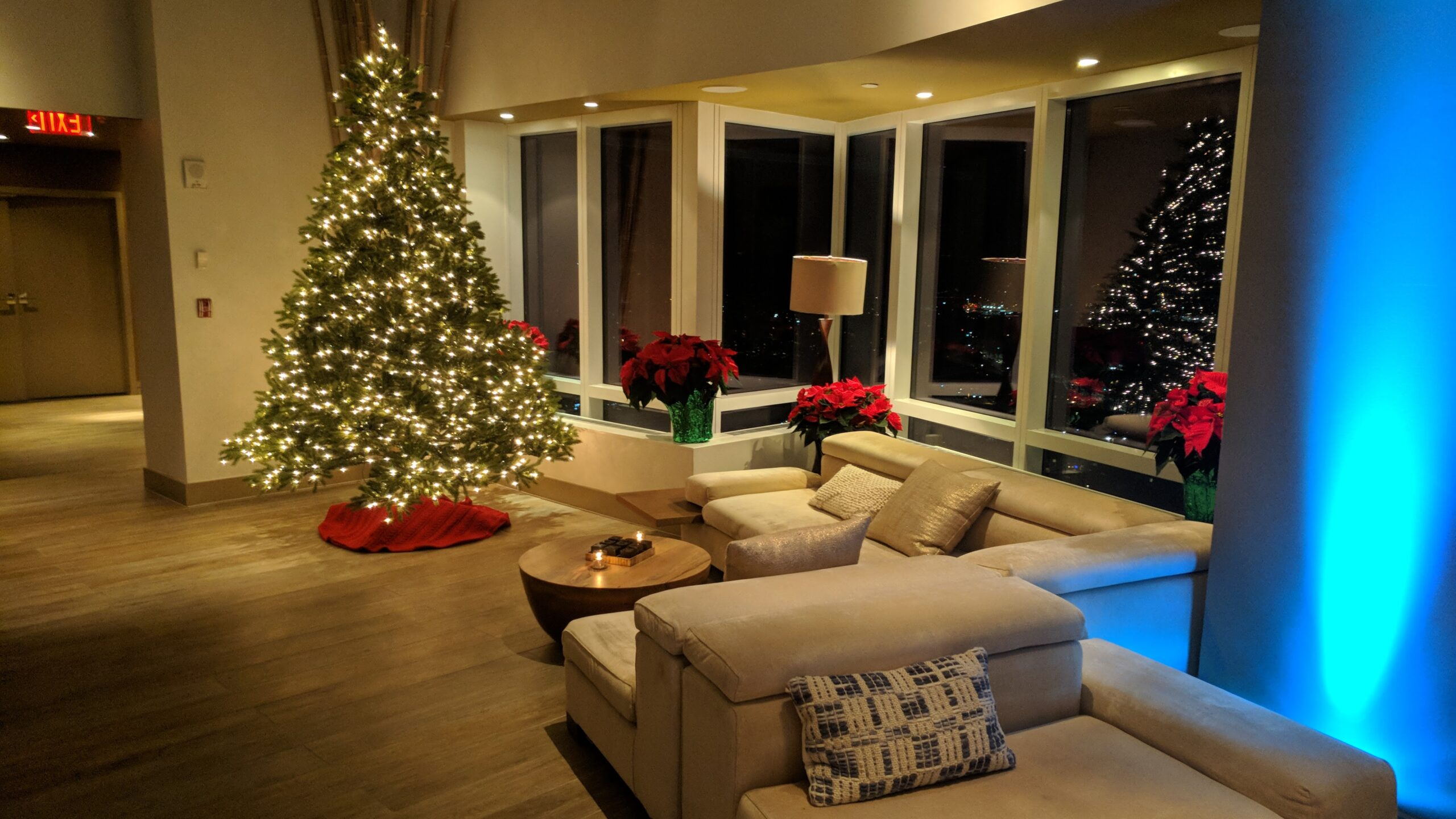 Christmas Tree Lounge with blue uplighting at Ritz-Carlton Westchester Holiday Parties NY