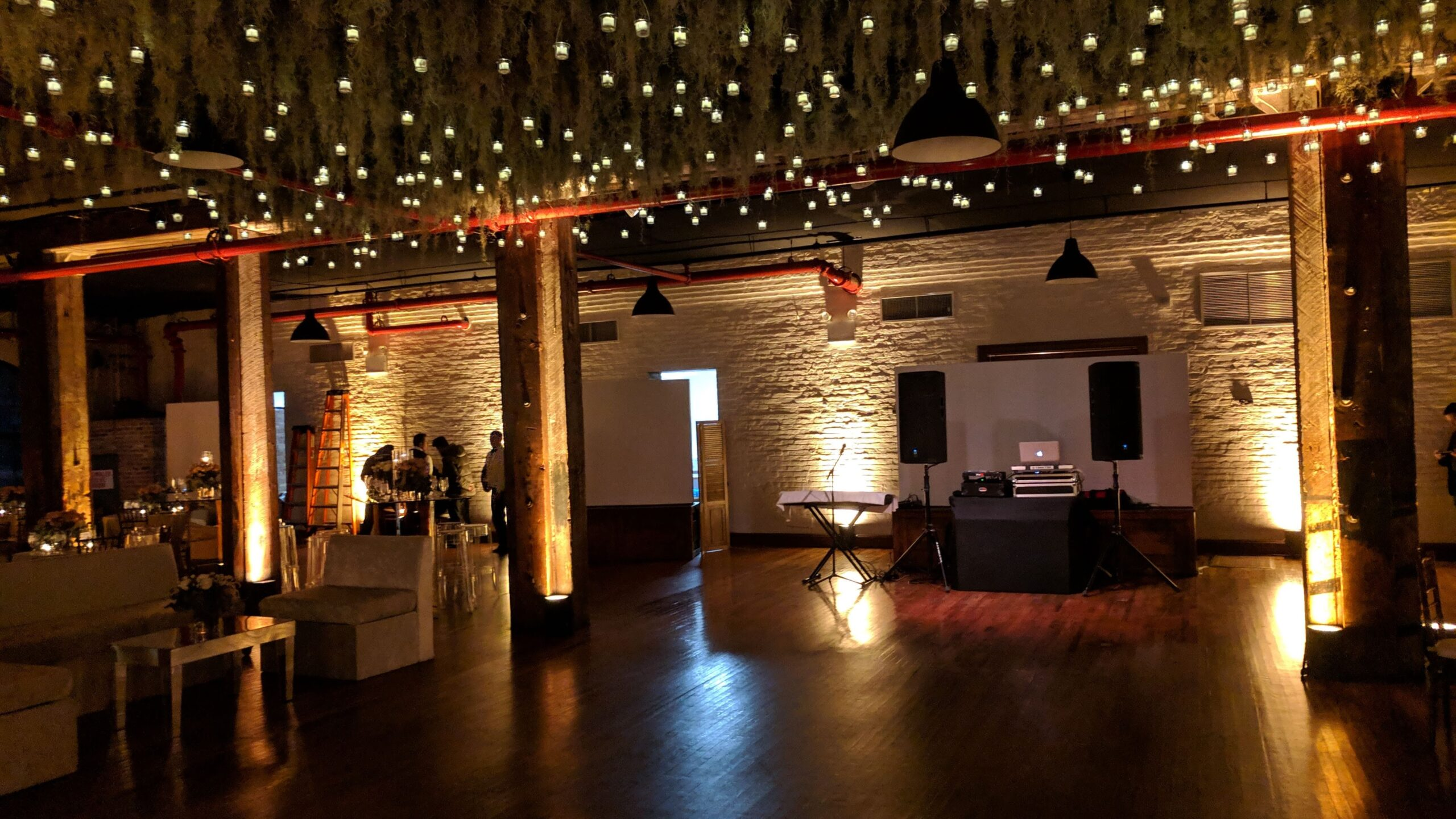 Rustic dancefloor before wedding reception with uplighting at the Liberty Warehouse in Brooklyn NY