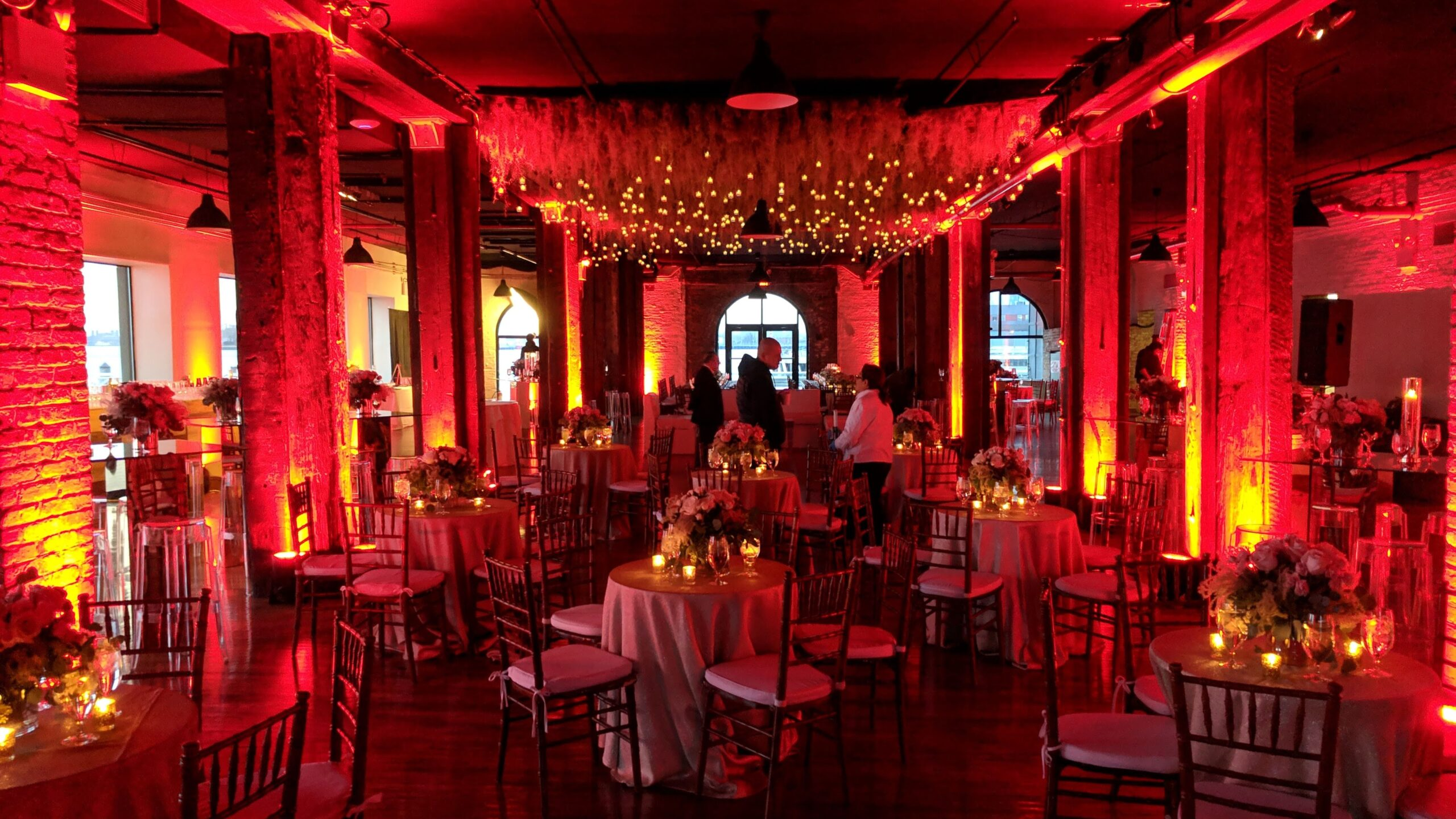 Dinner seating with Red Uplighting at Rustic wedding venue Libery Warehouse Brooklyn NY