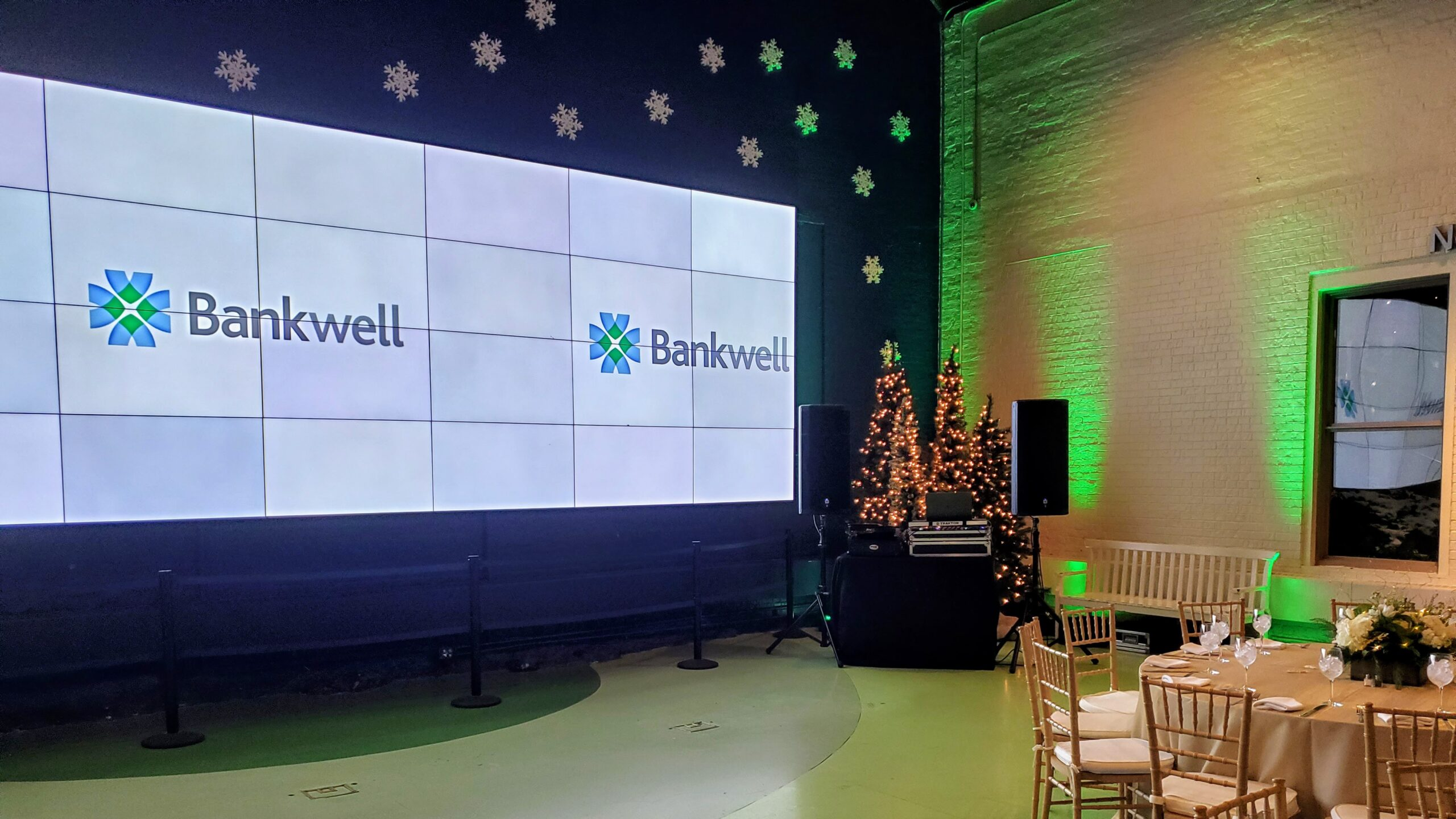 Video wall at Maritime Aquarium in Norwalk at a holiday party for Bankwell with logo