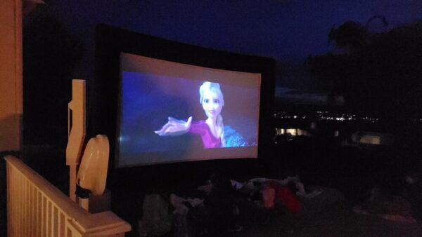 Big screen projection screen with Frozen movie outside